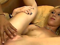 Blondie Maia Davis surrounded by black men on the bed