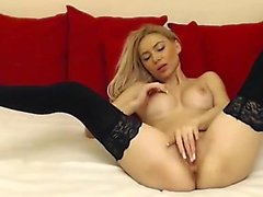 Blonde slut starts her thighs and fingers up herself