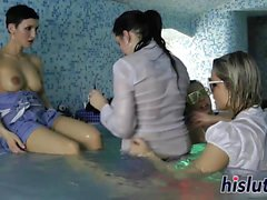 Reverse gangbang session in the pool