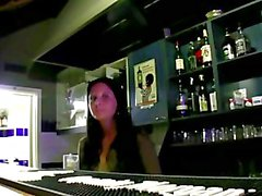 Bargirl gives a public blowjob