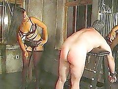 pareja dominación esclavitud azotaina fetiche
