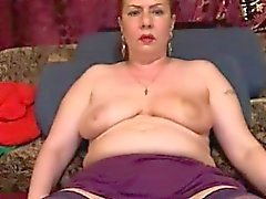Big breasted mature woman in stockings wraps her lips aroun