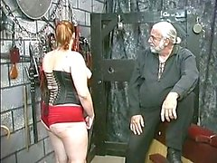 Young bdsm slave girl brunette in corset is spanked and caned in basement