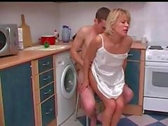 Russian mother with her son. Sex in the kitchen.