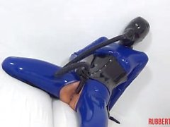 Rubber babe w mask playing w sniff dildo