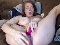 Redhead mature using different toys