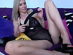Sexy blonde with the impossibly long legs rubs her pussy li