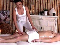 Classy erotic masseuse tugging client closeup