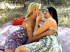 Teen and sexy milf licking in the park while having a picnic