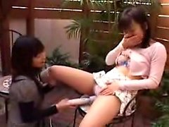 Two naughty Oriental teens play with sex toys and reach the