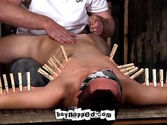 Blindfolded and secured to the bench Aiden Jason has no