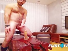 Hairy Stud Sits on His Big Dildo and Fires Off a Big Load