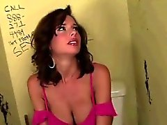 Glory hole catches busty brunette whores attention