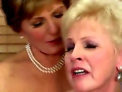 Two cougars share one cock