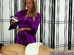Fetish masseuse rubs sexy babe