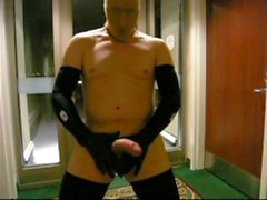 stocking masked biker jerks off in hotel hall