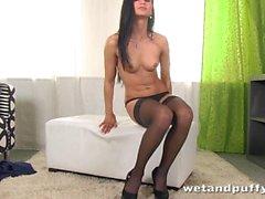 Elegant honey in sexy black stockings teasing herself