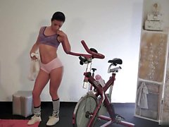 Brunette teen Lilly Foxx likes to ride the bicycle to...