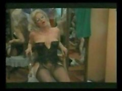 Karin Schubert is a classy blonde skank in black lingerie who does her guy