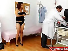 Gyno makes a busty lady with age strip down