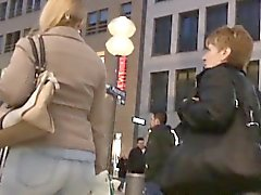 Spy cam in Russia is following around a crowd getting butt