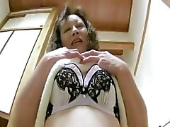 Oriental mature loves to play with toys