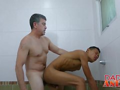 Asain cute stud gets banged in a bathroom by older dude