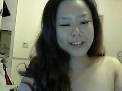 Adorable and puffy woman that is Oriental teasing the webca